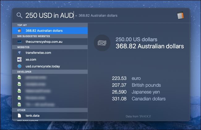 A macOS Spotlight Search for Currency Conversion.